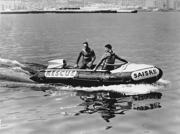 The first Sea Rescue boat donated to the NSRI by the Society of Master Mariners in 1967. The late Captain Bob Deacon is on the helm and the late Ray Lant is the crewman.