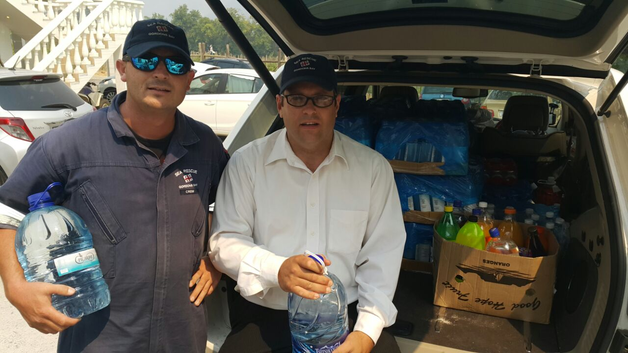 Gordons Bay NSRI crew Neill Slater and Ryan Holmes deliver the supplies.