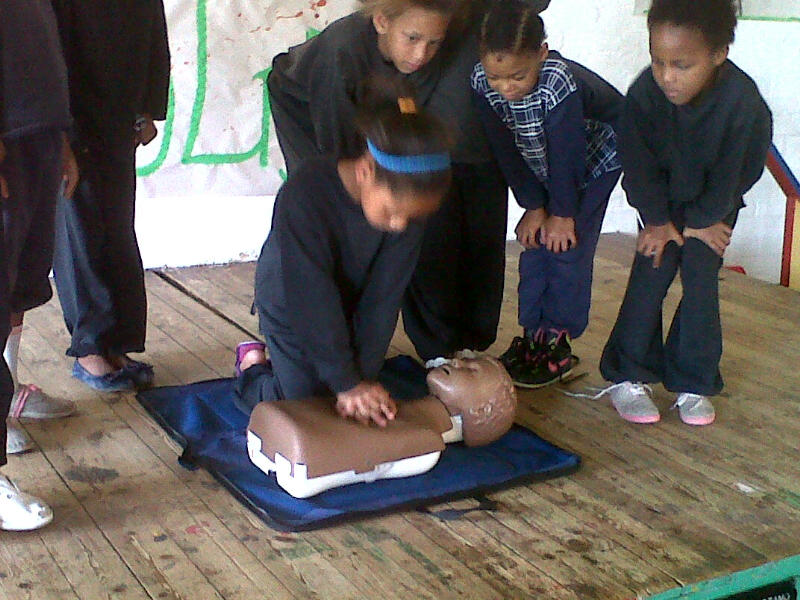 The children learn how to do CPR.