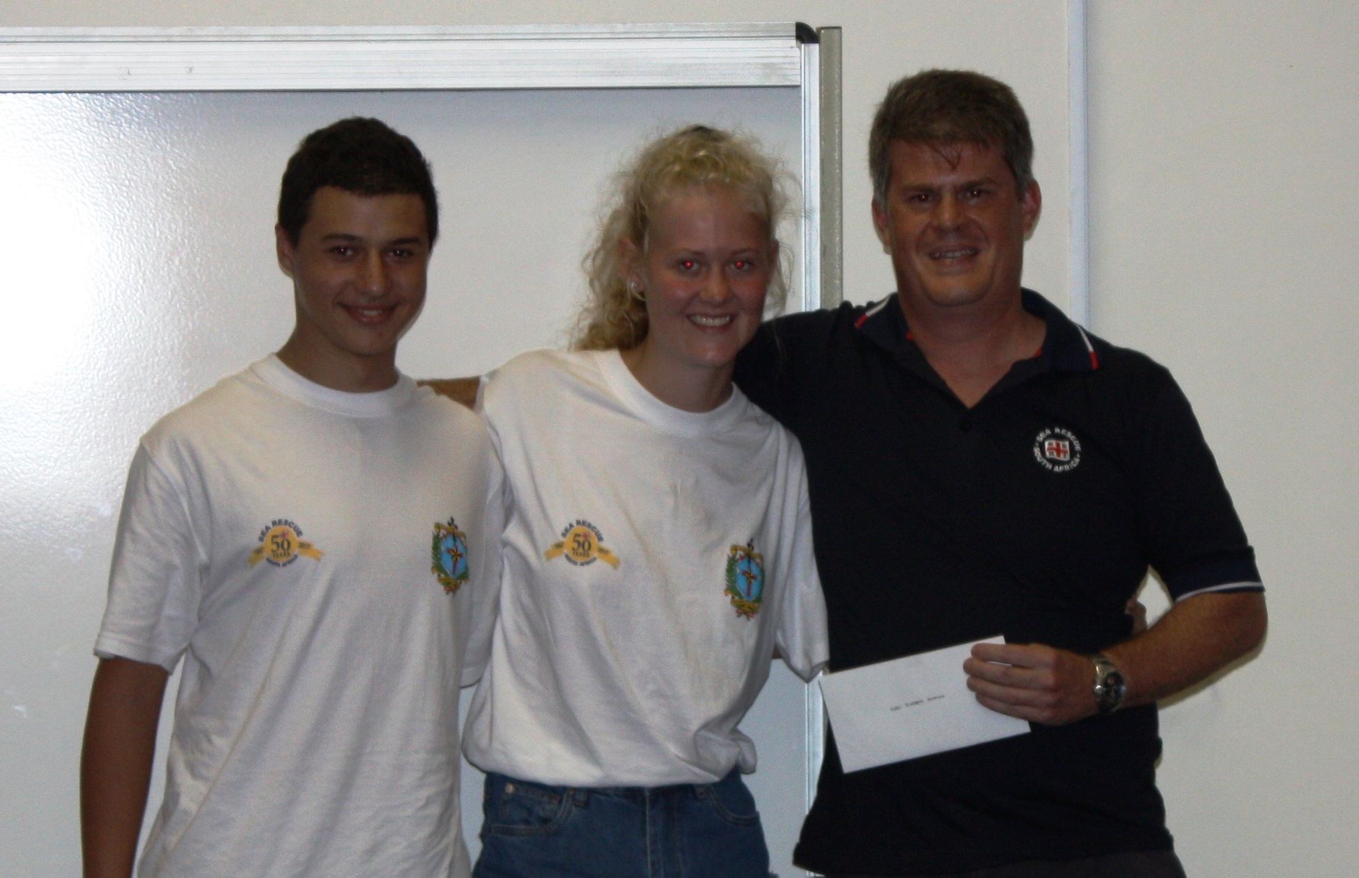From left: Alan du Trevou, Morgan Cordier handing over cheque to Clifford Ireland (Station Commander)