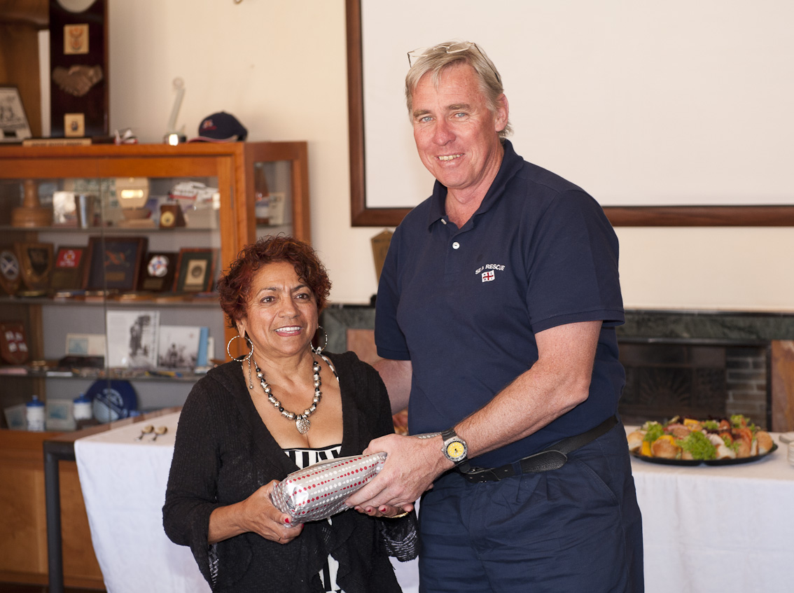 Anita is given a farewell present by CEO Cleeve Robertson.
