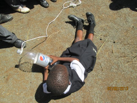 A bottle and rope can be used as a life saving tool.