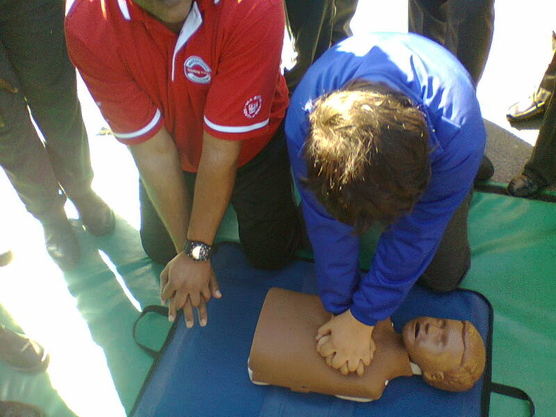 A Belthorn primary school learner practices CPR.