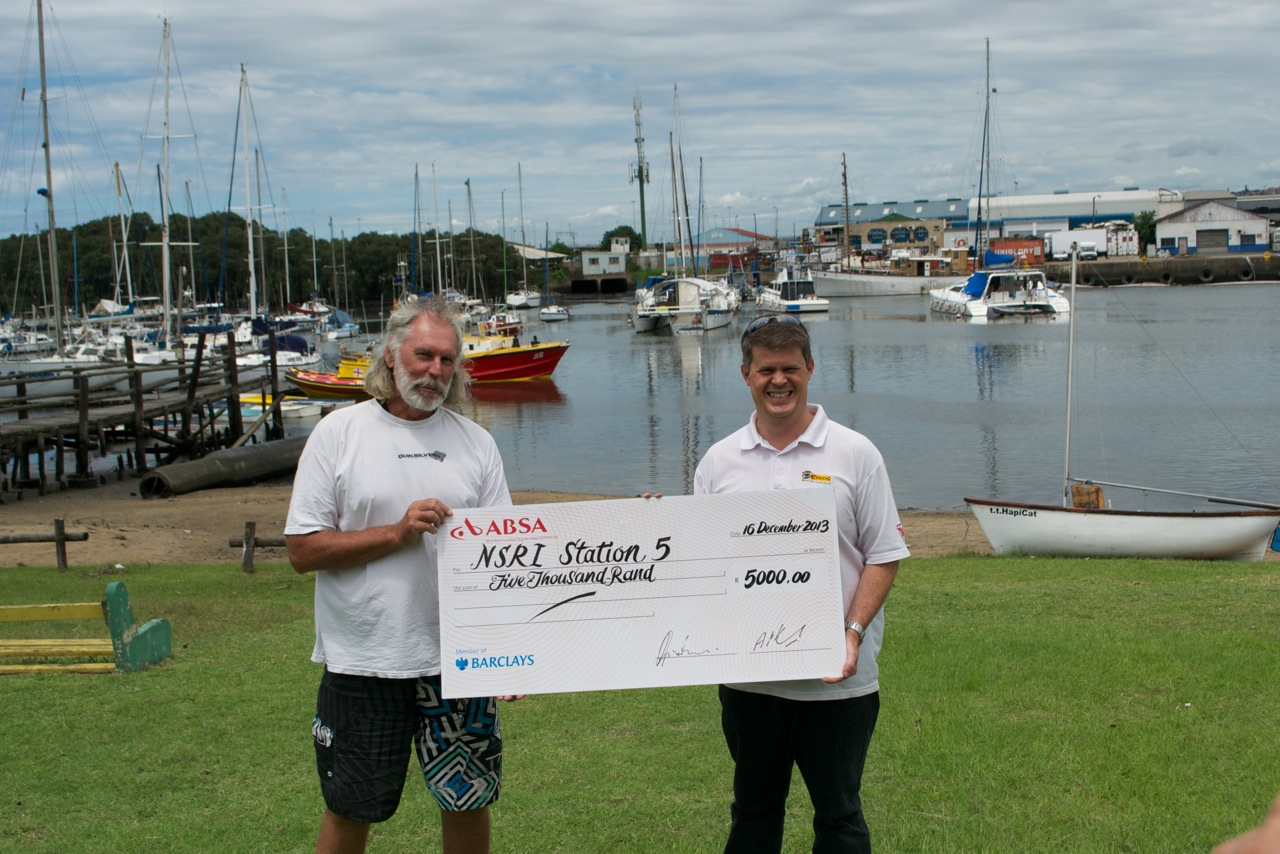 Clifford Ireland accepting a cheque for R5000 from BYC.