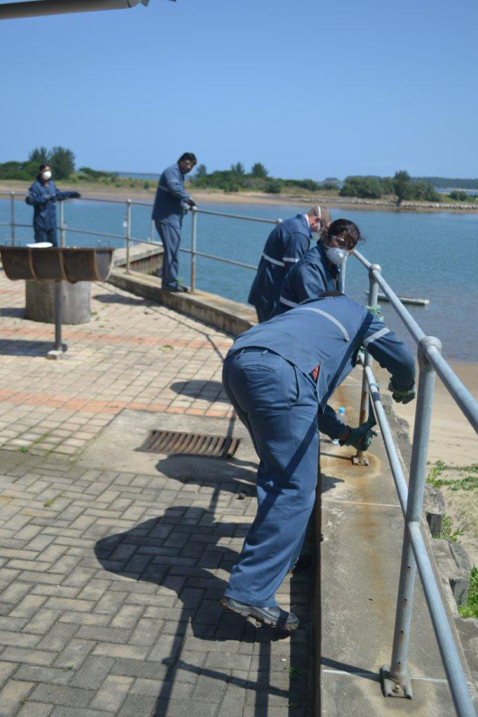 Bayside Maintenance crew busy sanding the railings down.