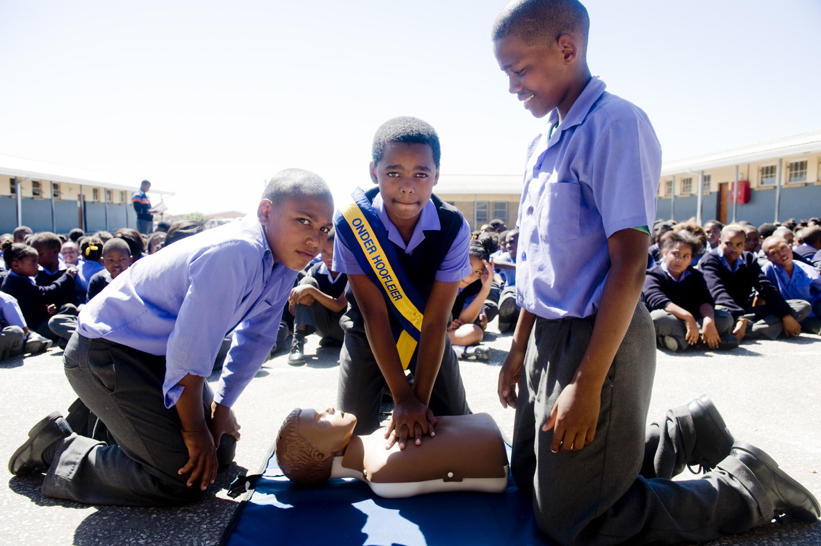 Davon Geland (12), Adrian Frans (12), Jamian (13) from St Blaize, trying CPR.