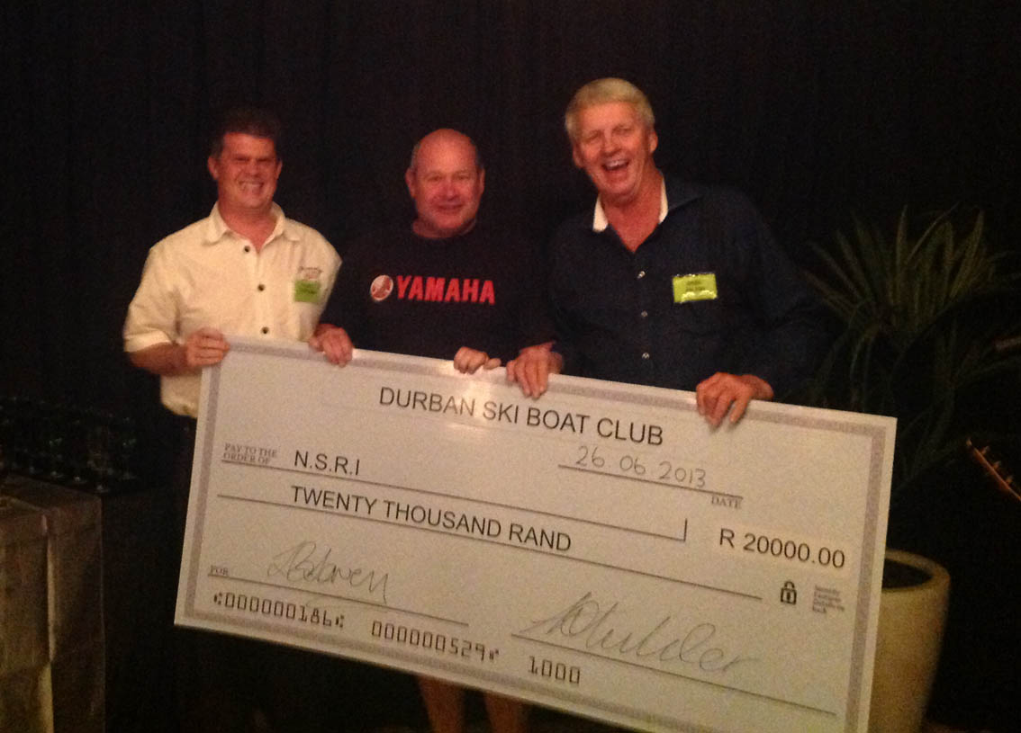 Clifford Ireland receives the donation from Shaun Lavery and Hilton Kidger.