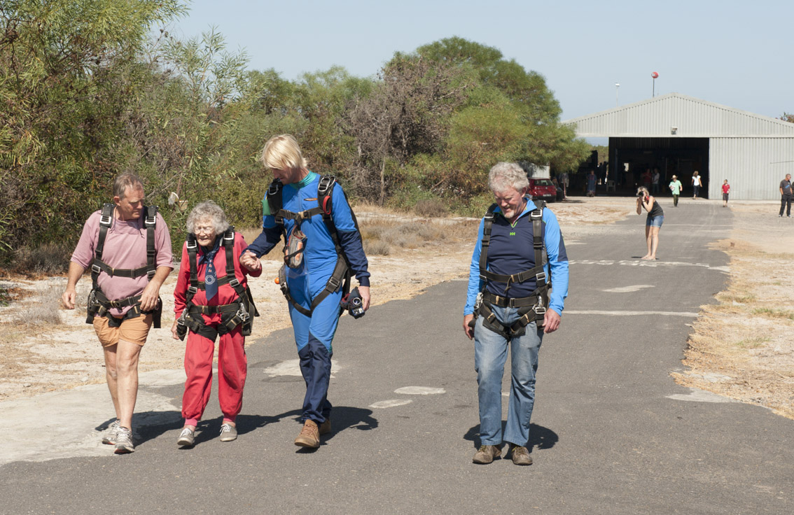 Georgina walks out to the plane for her jump with her tandem master and two sons.