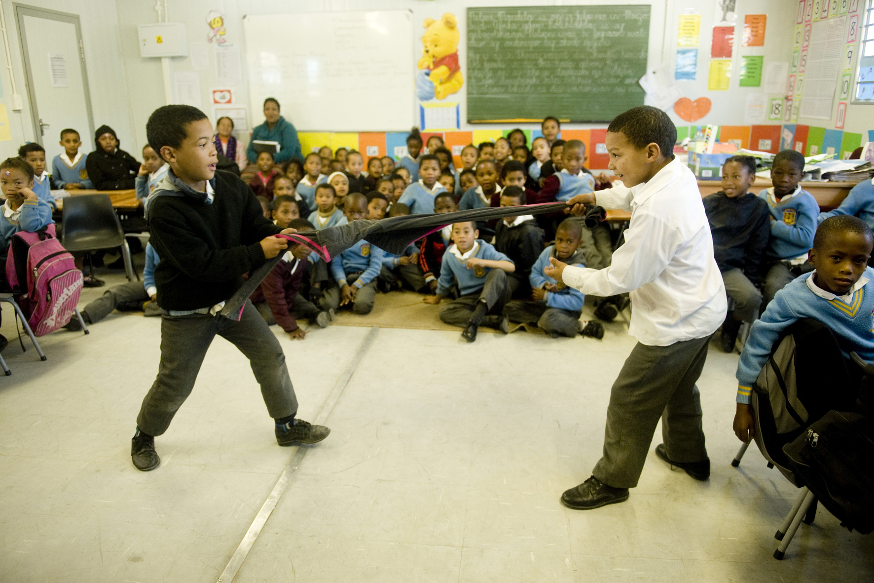 Giovanne (7) & Gevique (8) from Concordia Primary, demonstrating how to save a friends life, using a pair of pants.