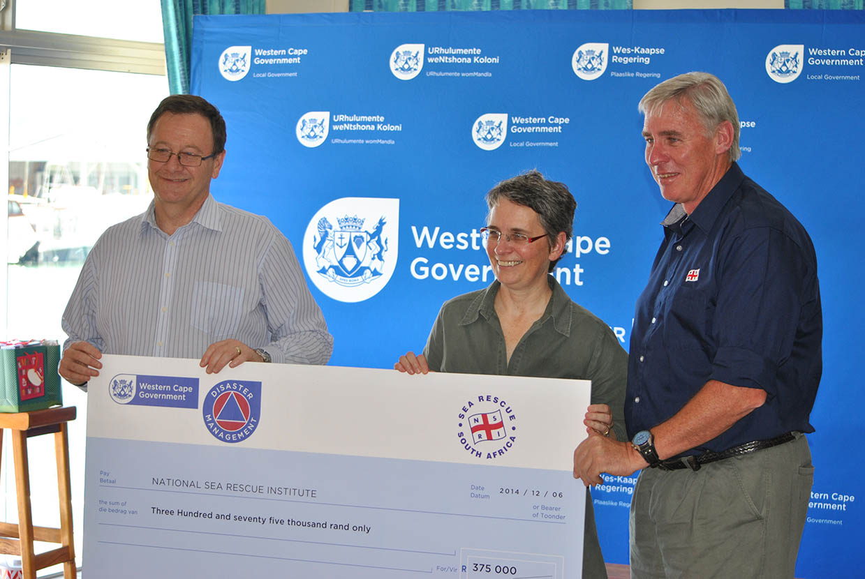 Minister Anton Bredell and Dr Hildegaard Fast with NSRI CEO Dr Cleeve Robertson.