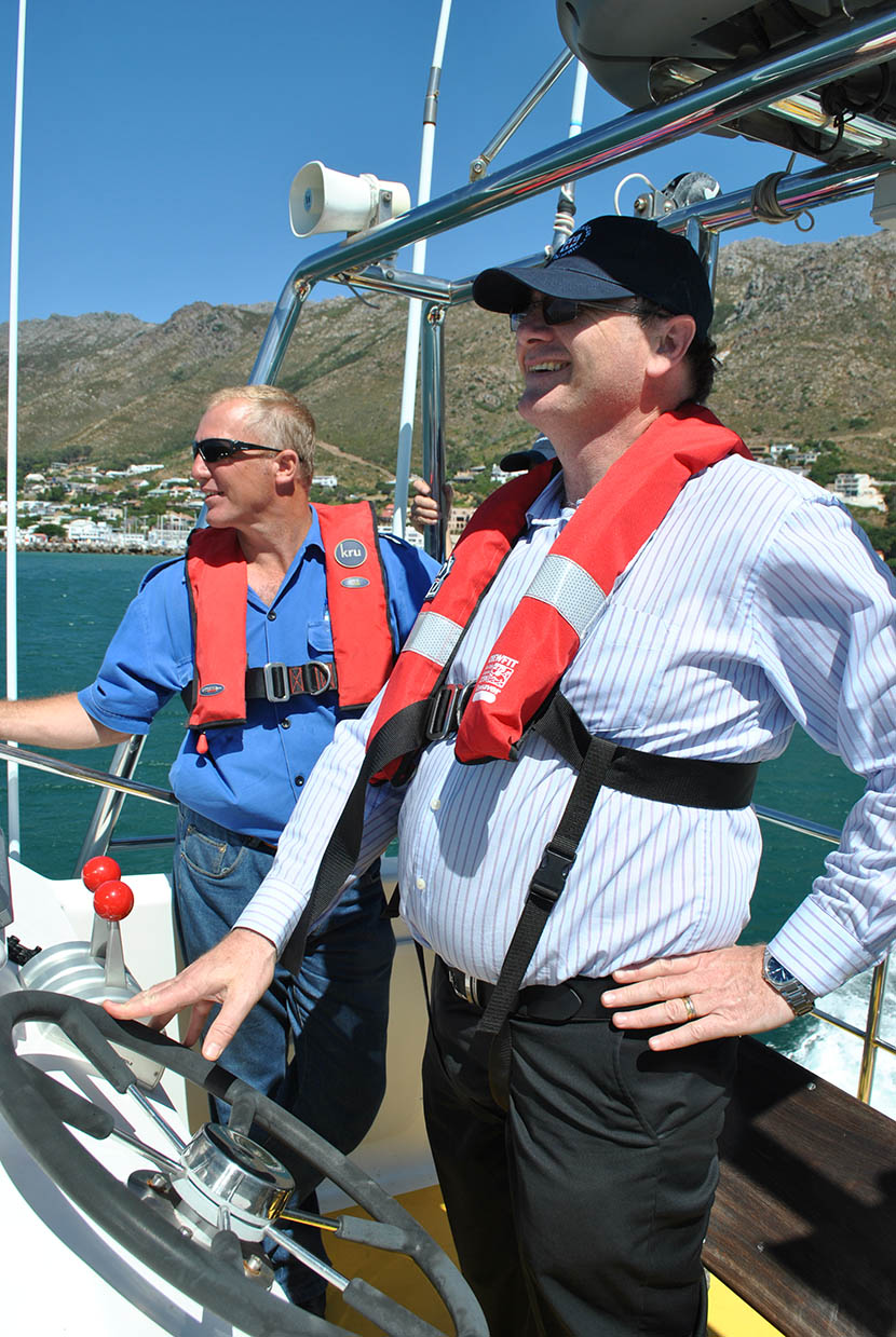 Minister Anton Bredell at the helm of the Sea Rescue boat Jack Riley.