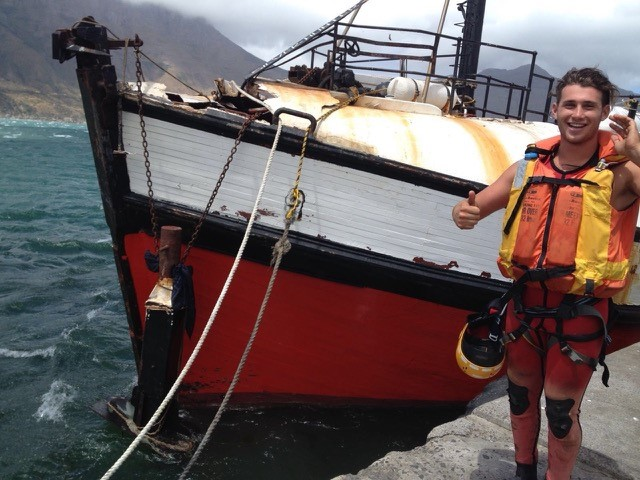 Pic by Bevan Geyser showing the close up of the bow of the casualty and Station 8 Hout Bay's Jason de Villiers standing on the jetty