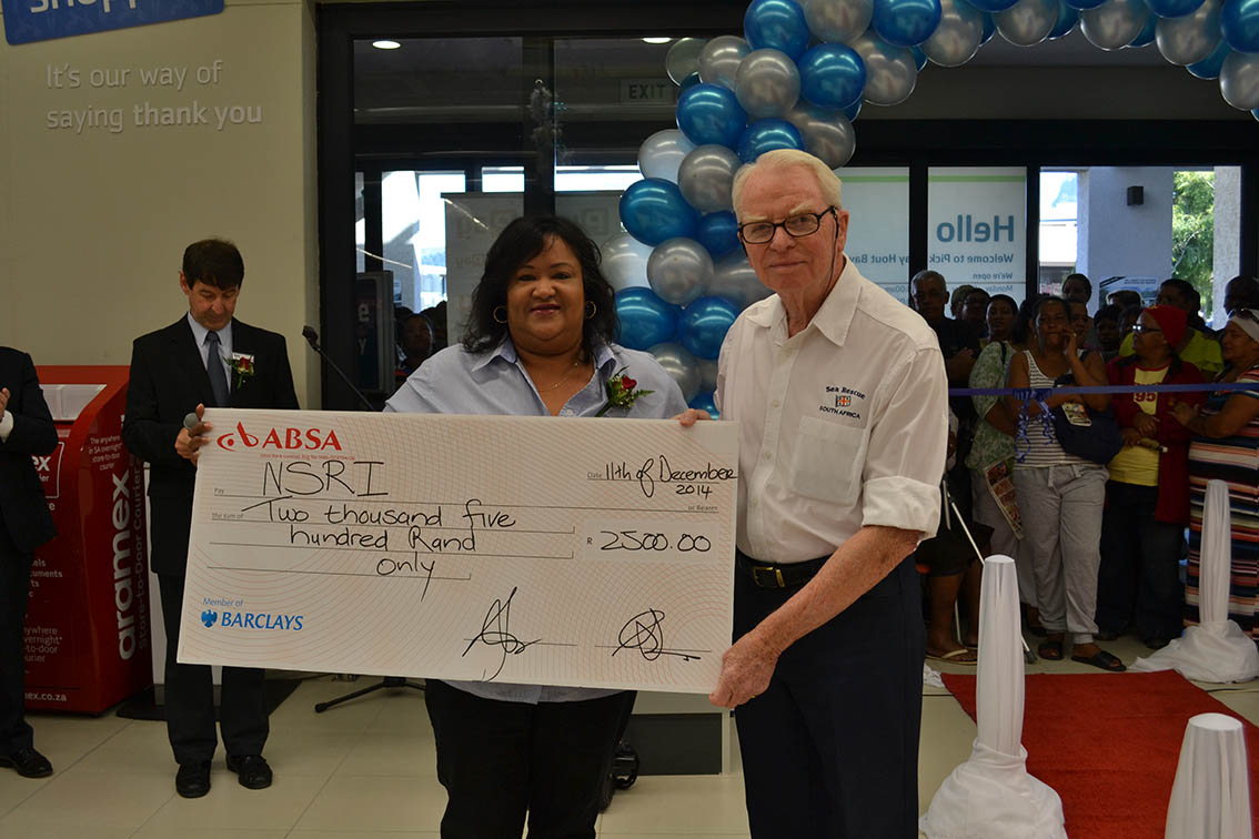 Chris Hudson, an Honorary Life Governor of Sea Rescue receives the cheque from Michelle Smith, Frontline Co-ordinator of Pick n Pay Hout Bay.