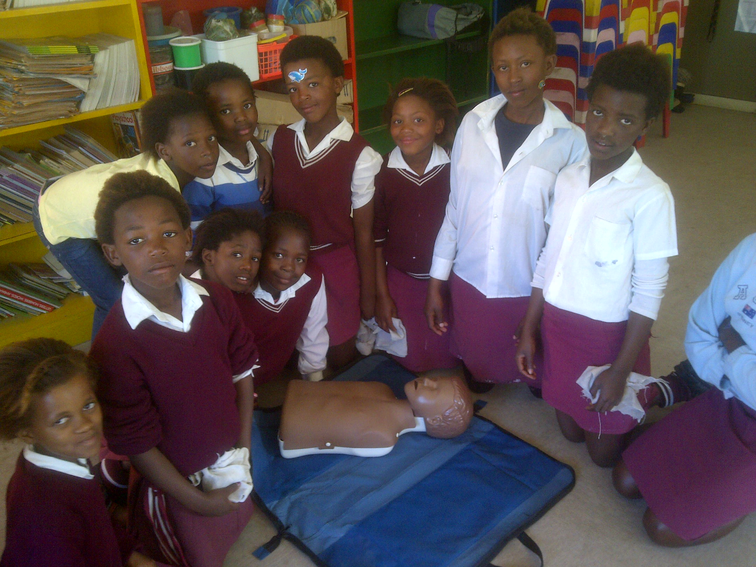 Learners from Colleen Glen Primary about to learn how to do CPR.