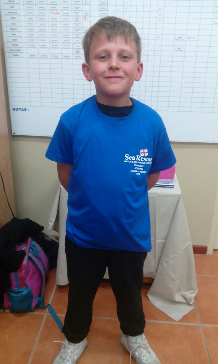 Enrico's son Max proudly wearing a Sea Rescue Junior Academy t-shirt.