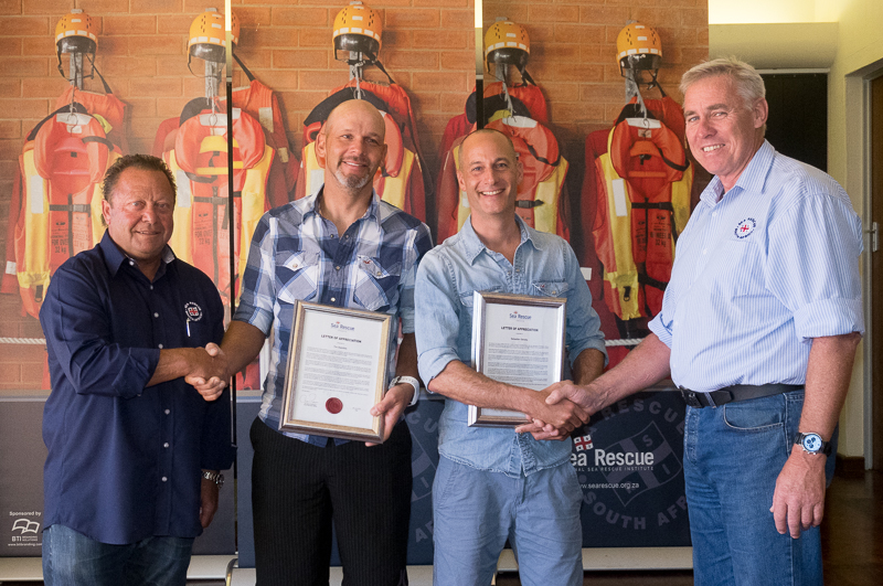From left: Howard Godfrey (Chairman of the NSRI Awards Committee, Sebastian Deneke, Tim Steinfels and Dr Cleeve Robertson (NSRI CEO)