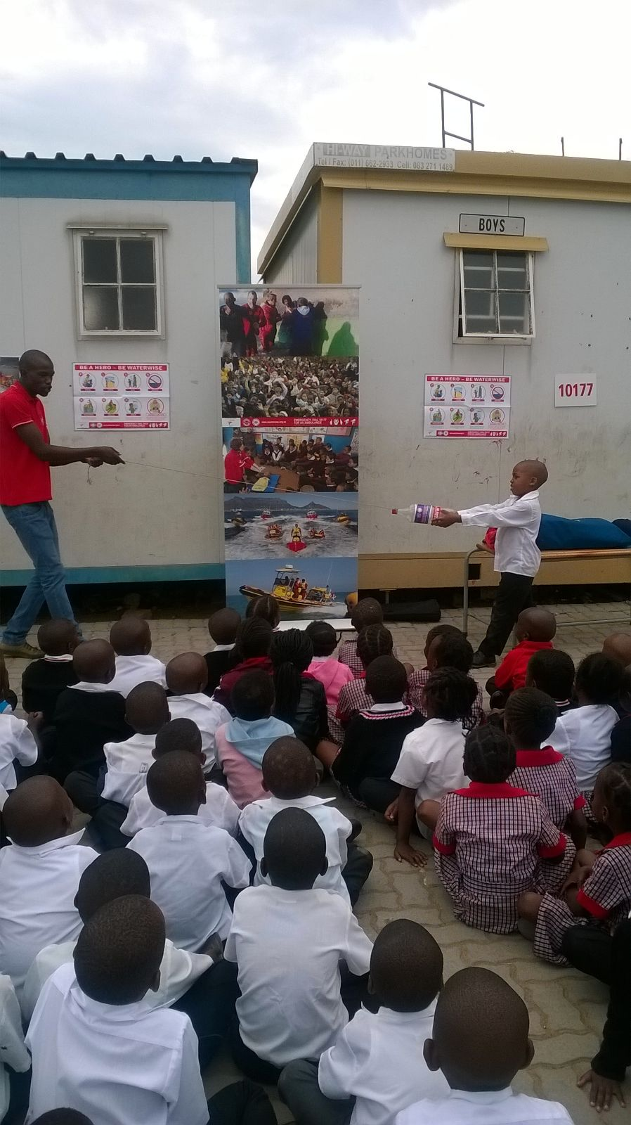 Percy teaches Diepsloot Primary children about peer rescue.