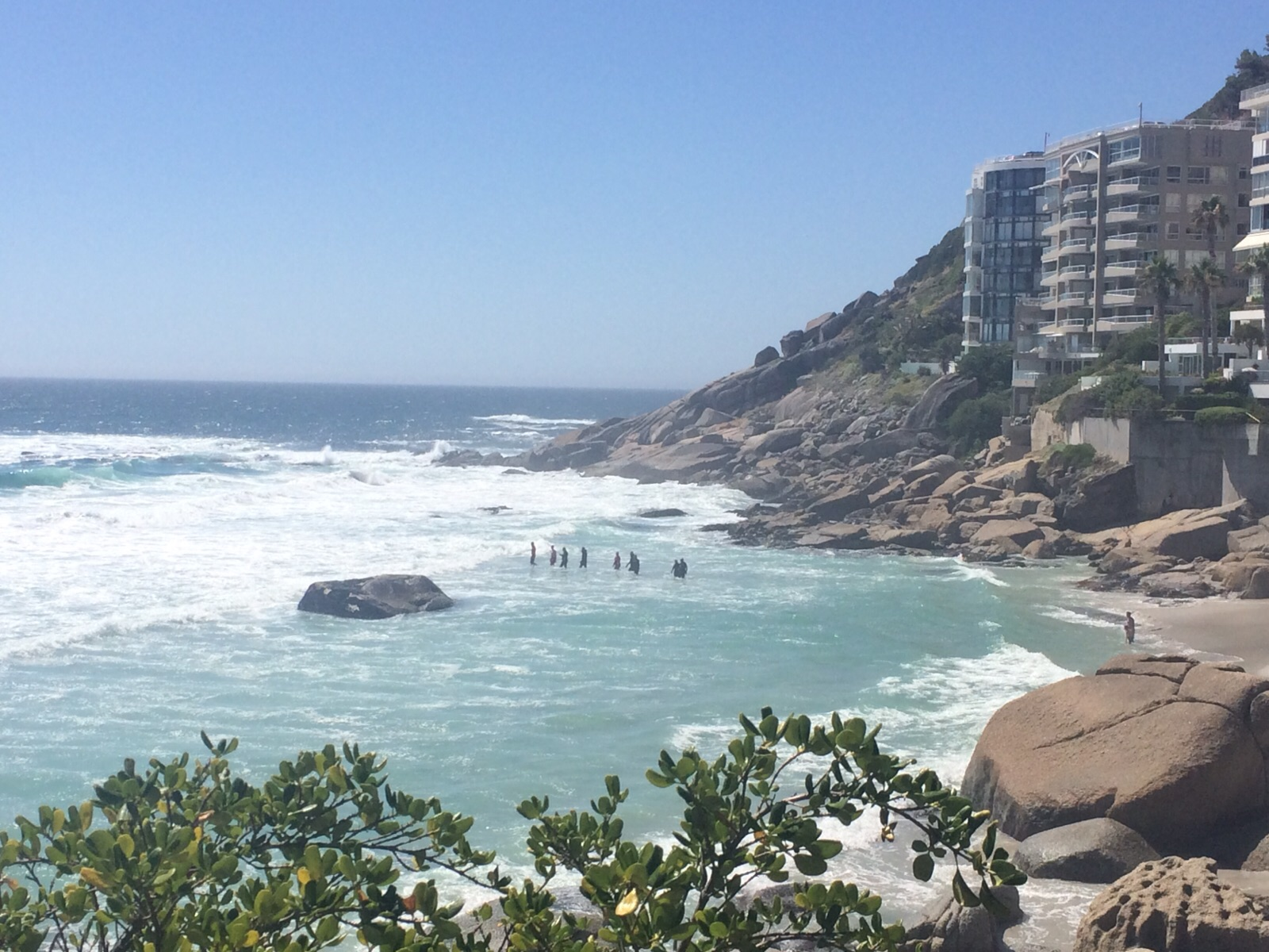 Rescuers search for the missing boy at Clifton.