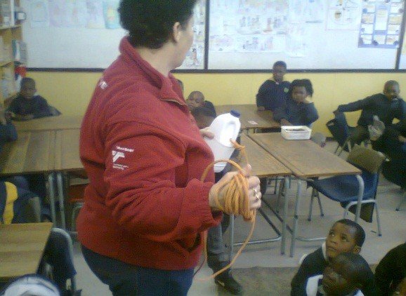 Pictured above is Desiree demonstrates how to make a throw bag by using a plastic bottle.