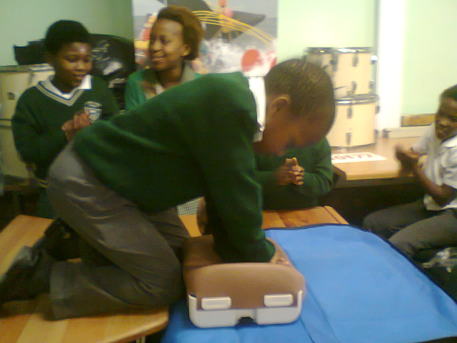 Imboniselo grade 4 children doing hands on CPR.