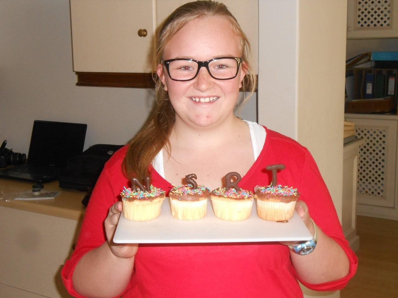 Jessica Garshagen and the cup cakes that she made for NSRI's Life boat Circle.
