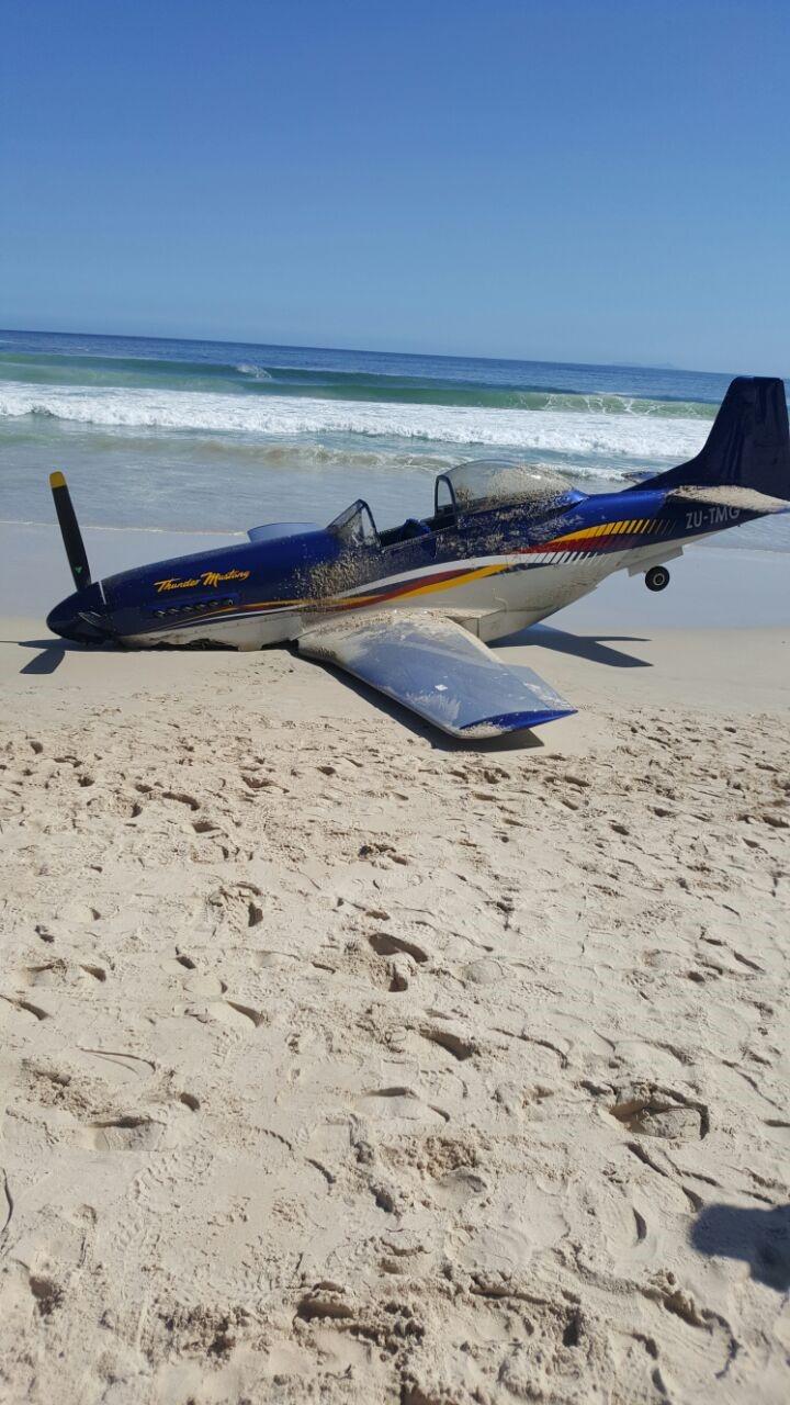 NSRI Gordons Bay shows the light aircraft on the beach.