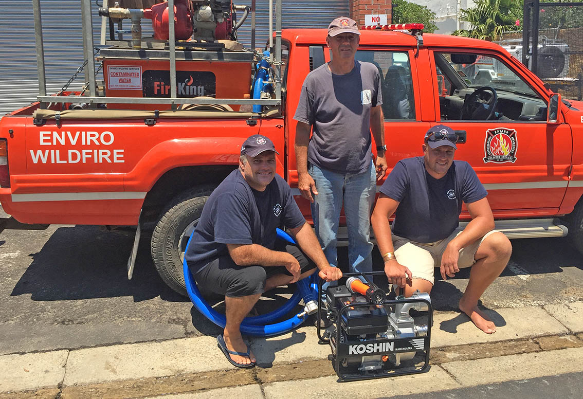 From left to right, Dave Smith, Rob Erasmus, and Mark Knight with the new pump.