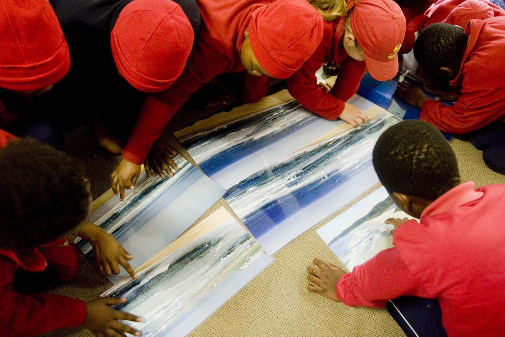 Learners from Stepping Stones School in Knysna looking at images of Rip Currents.