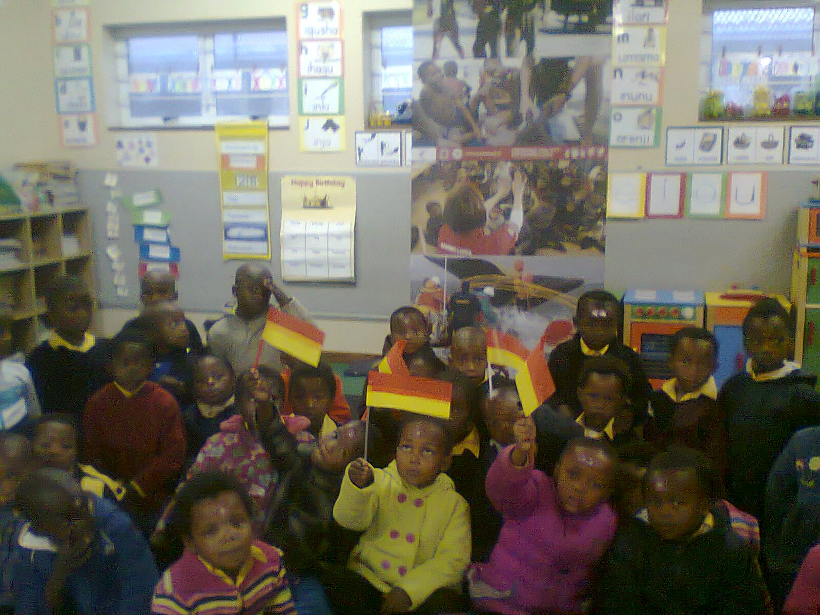 Mbekweni grade 1 children learn what lifesavers flags look like on the beach.