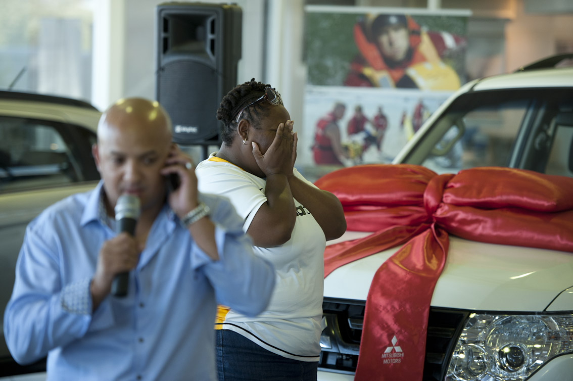MC for the event Kino Kammies calls Judge Nkosi as his daughter Yolisa reacts to her father winning. The 2013 double Mitsubishi car draw was held at the Mitsubishi show rooms in Paarden Island today,