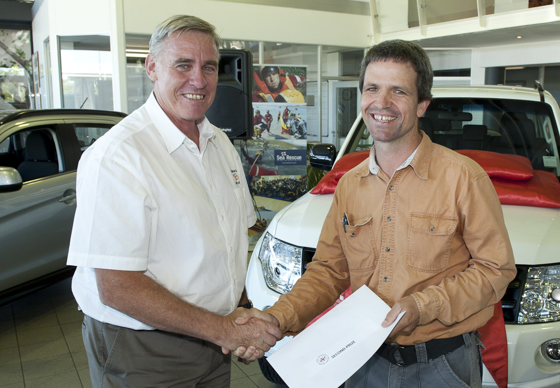 NSRI CEO Cleeve Robertson hands Paul Herrmann second prize.