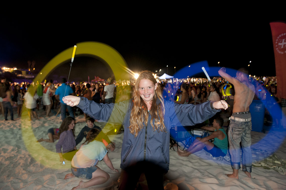 Donna with two glow sticks that were sold in aid of NSRI.