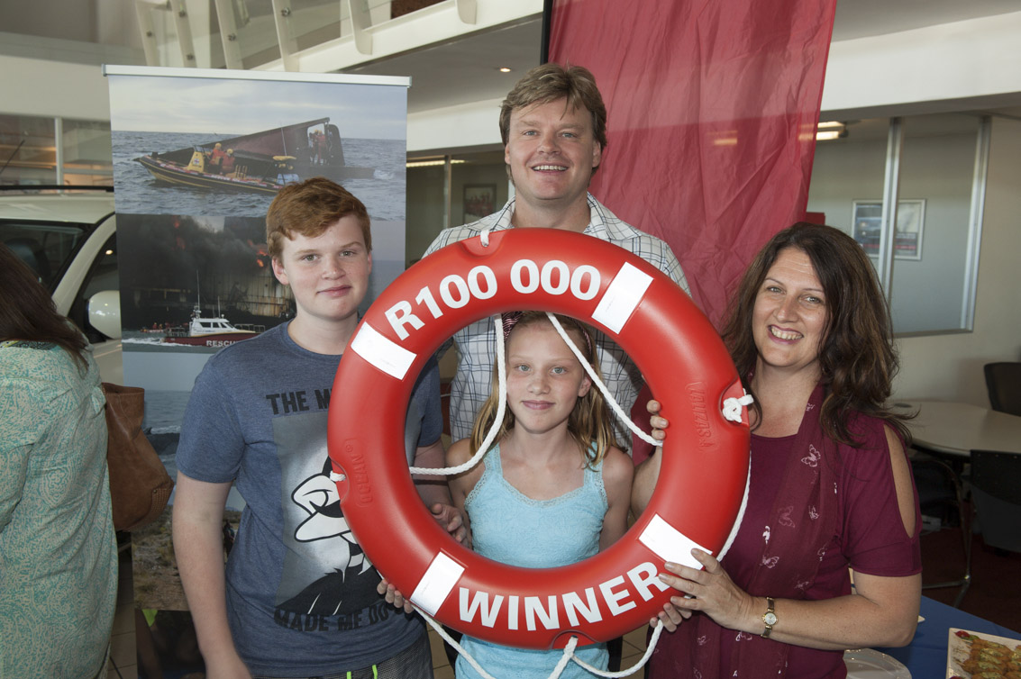 The R100 000 'once-off' annual cash prize for the NSRI Debit Order Competition was won by Dr. Grant Fourie here pictured with his family Brandon, Shawn and Ashley.