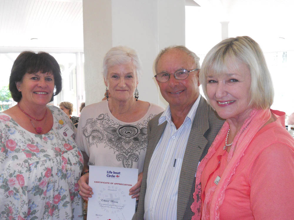 Mr and Mrs Bowser getting certificate at the Benjamin.Margaret McCulloch is on the left and Janet Burgess on the right.