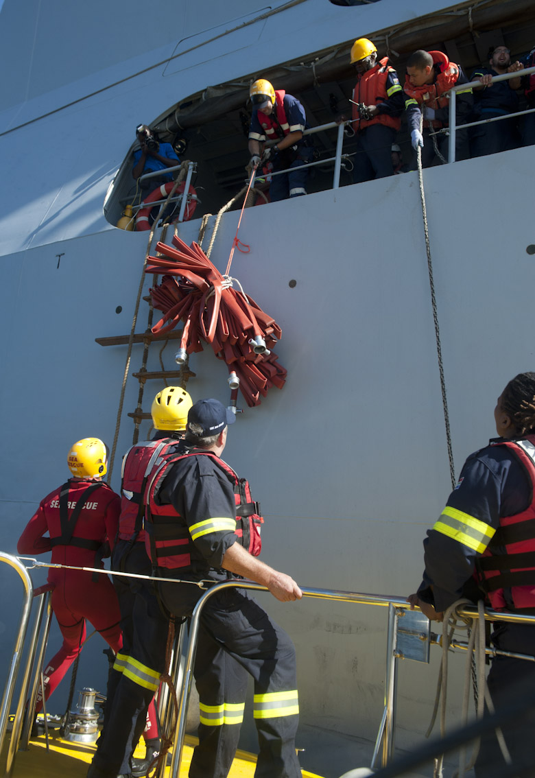 Fire fighting equipment is taken aboard the ship.