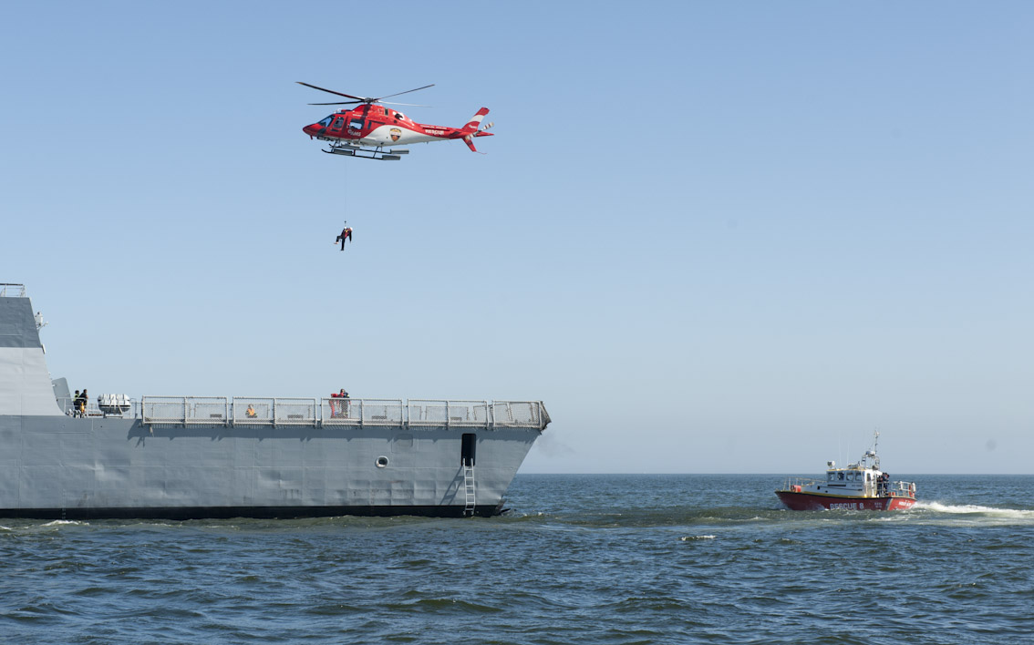 "The AMS helicopter lifts a ""casualty"" off the ship."