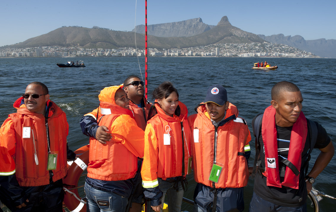 """Passengers rescued off the passenger liner"" on the rescue boat Spirit of Vodacom wait to be taken to shore."