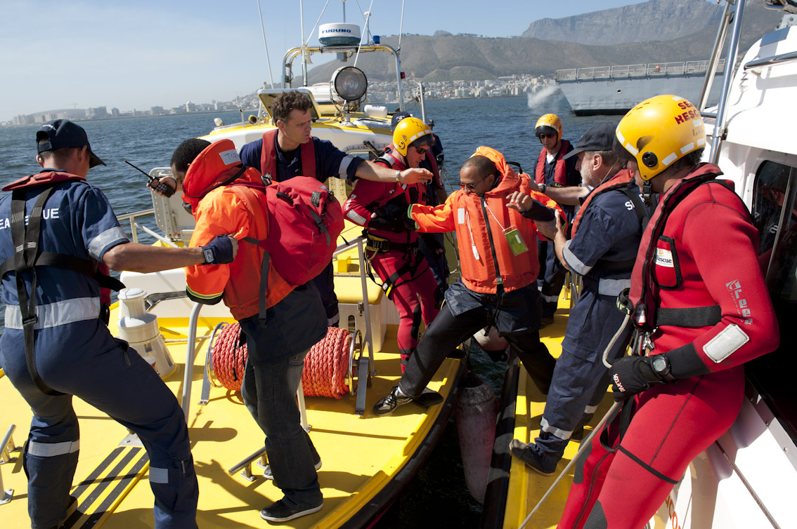 Passengers are transferred between Sea Rescue boats during the exercise.
