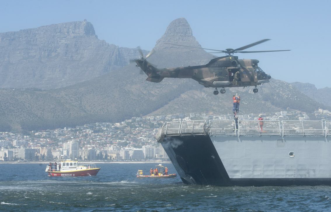 "An Oryx helicopter from The SAAF's 22 squadron lift two ""casualties"" off the ship."