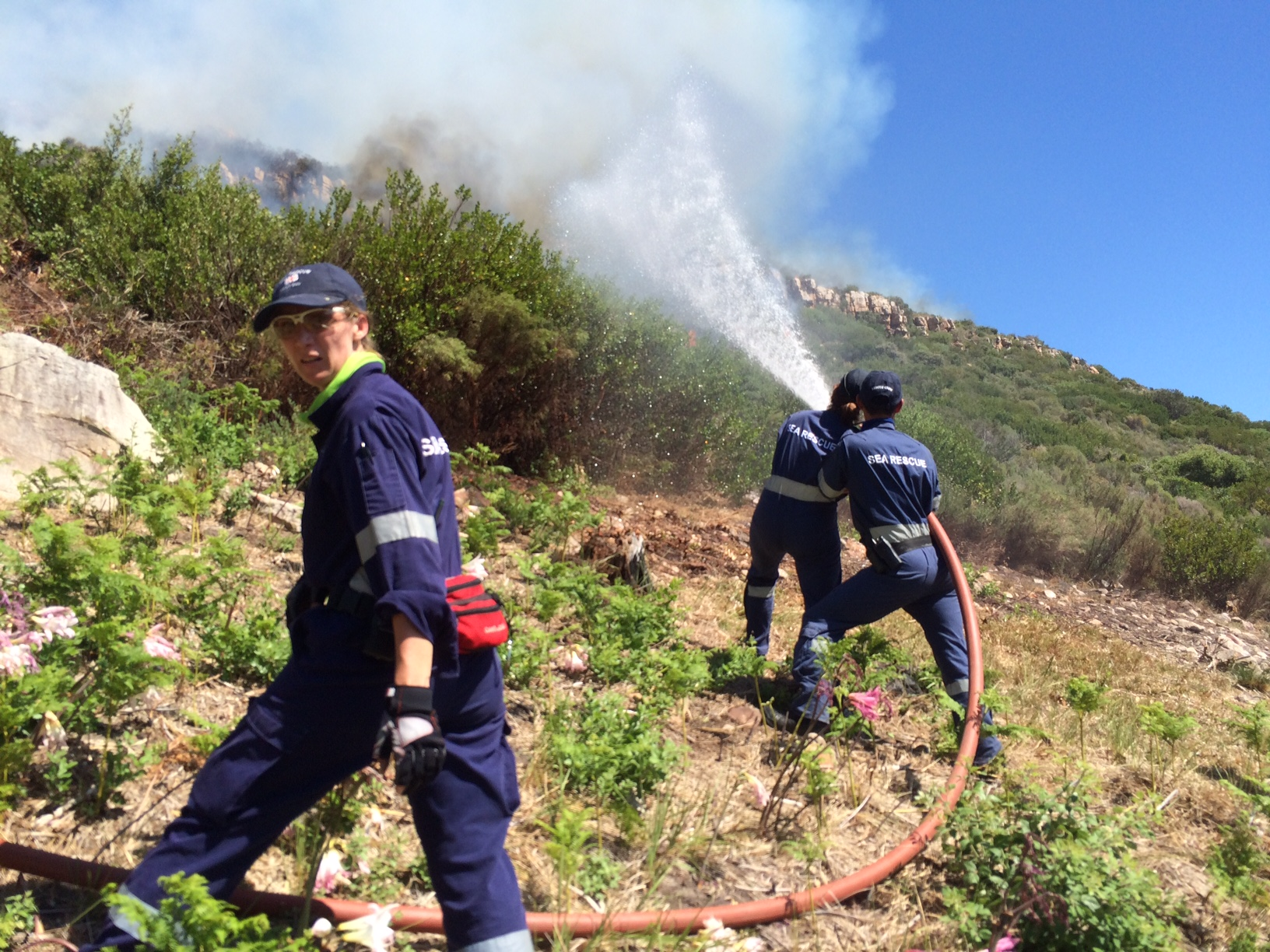 NSRI Hout Bay volunteers Carmen Long, Paul and Cherelle Leong and Spencer Oldham have joined the firefighters at Baviaanskloof.