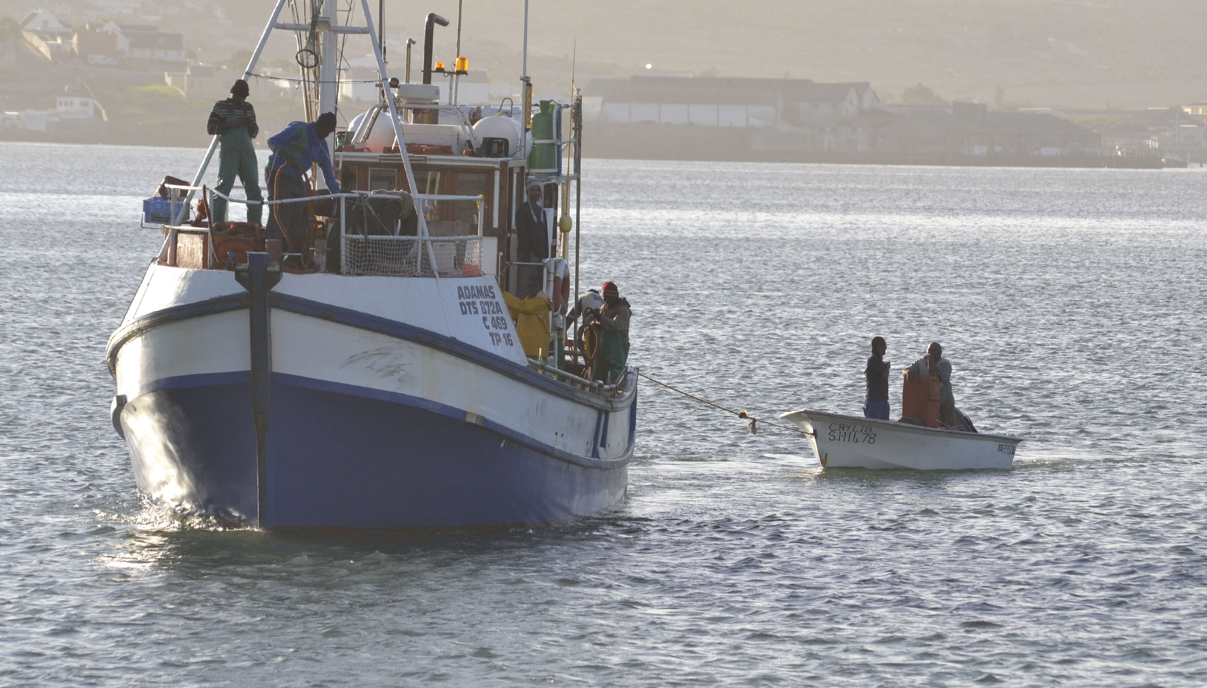 Christy Jordaan, 59, and his son Brandon 36, are towed in to Saldanha by the fishing boat Adamas. Picture Belinda Rother/NSRI.
