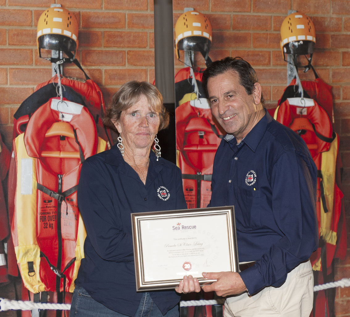 Pamela St Claire-Laing receives her 20 years service award from NSRI Chairman Ronnie Stein Picture Andrew Ingram / Sea Rescue