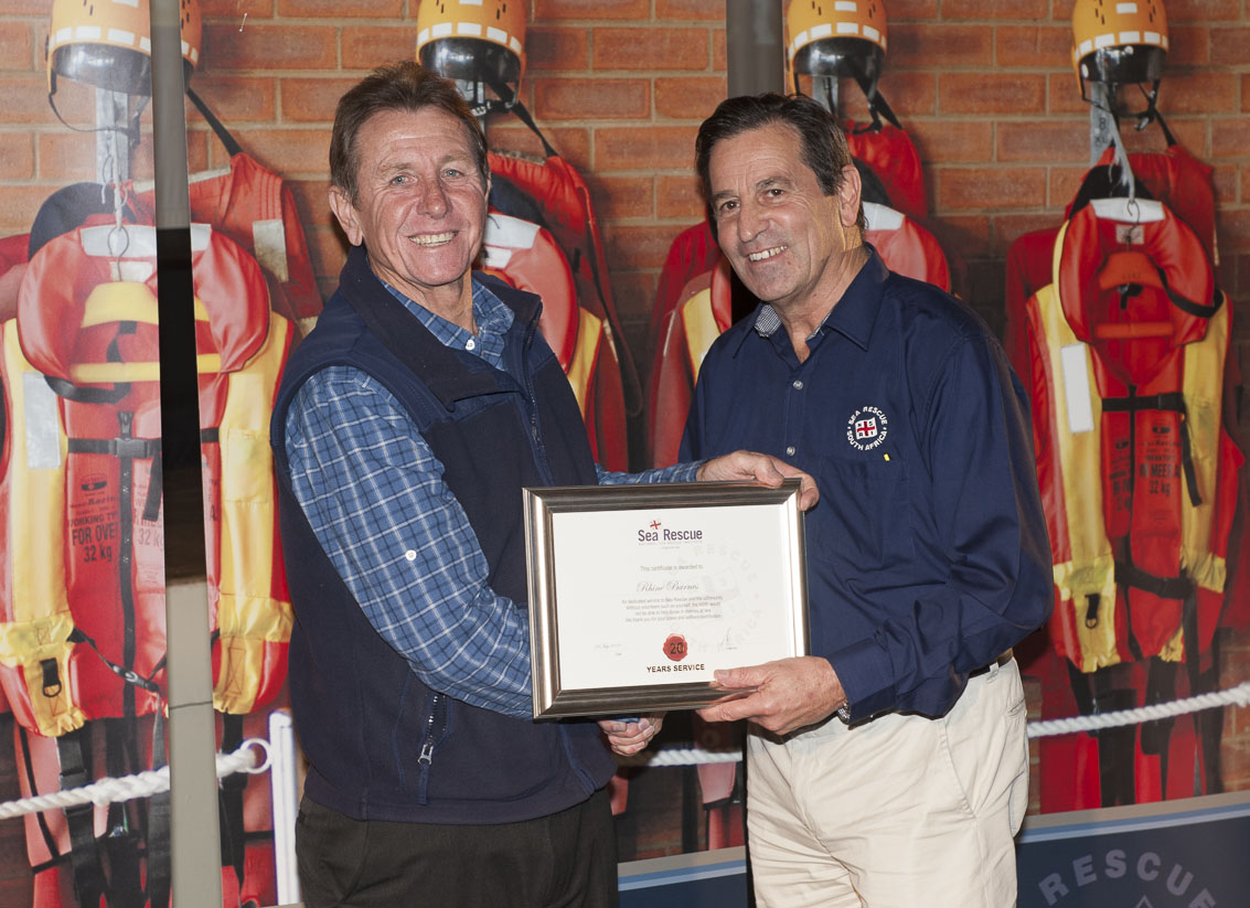 Rhine Barnes receives his 20 years service award from NSRI Chairman Ronnie Stein Picture Andrew Ingram / Sea Rescue