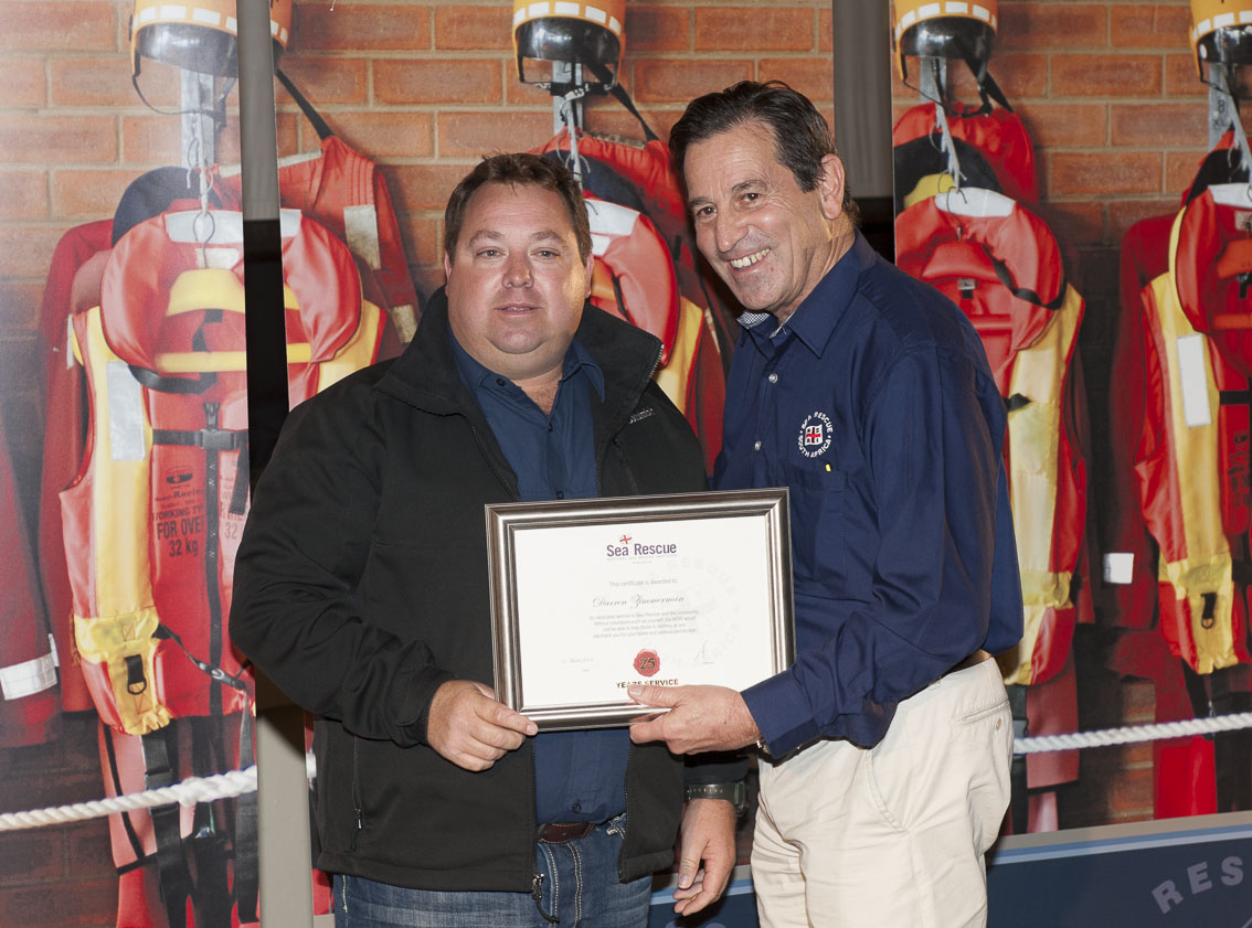 Darren Zimmermann receives his 25 years service award fromby NSRI Chairman Ronnie Stein