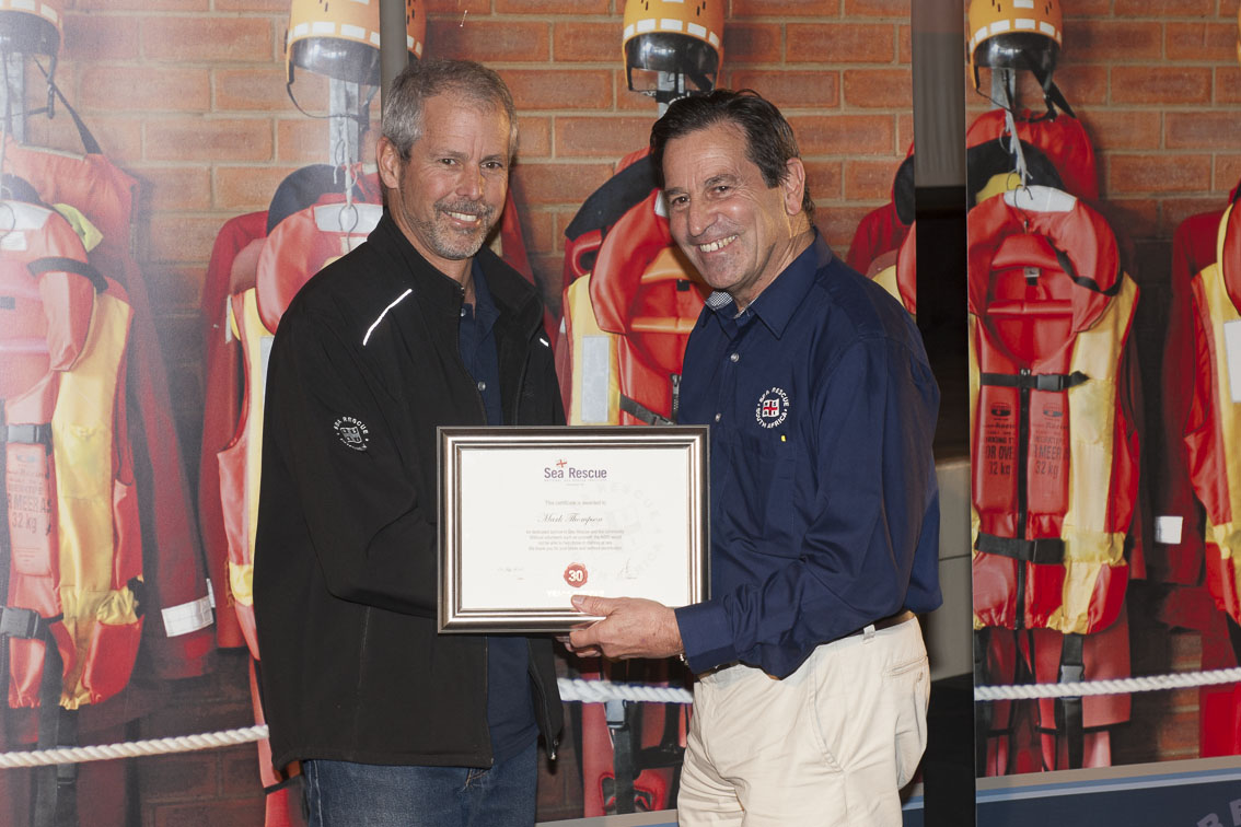 Mark Thompson receives his 30 years service award from NSRI Chairman Ronnie Stein
