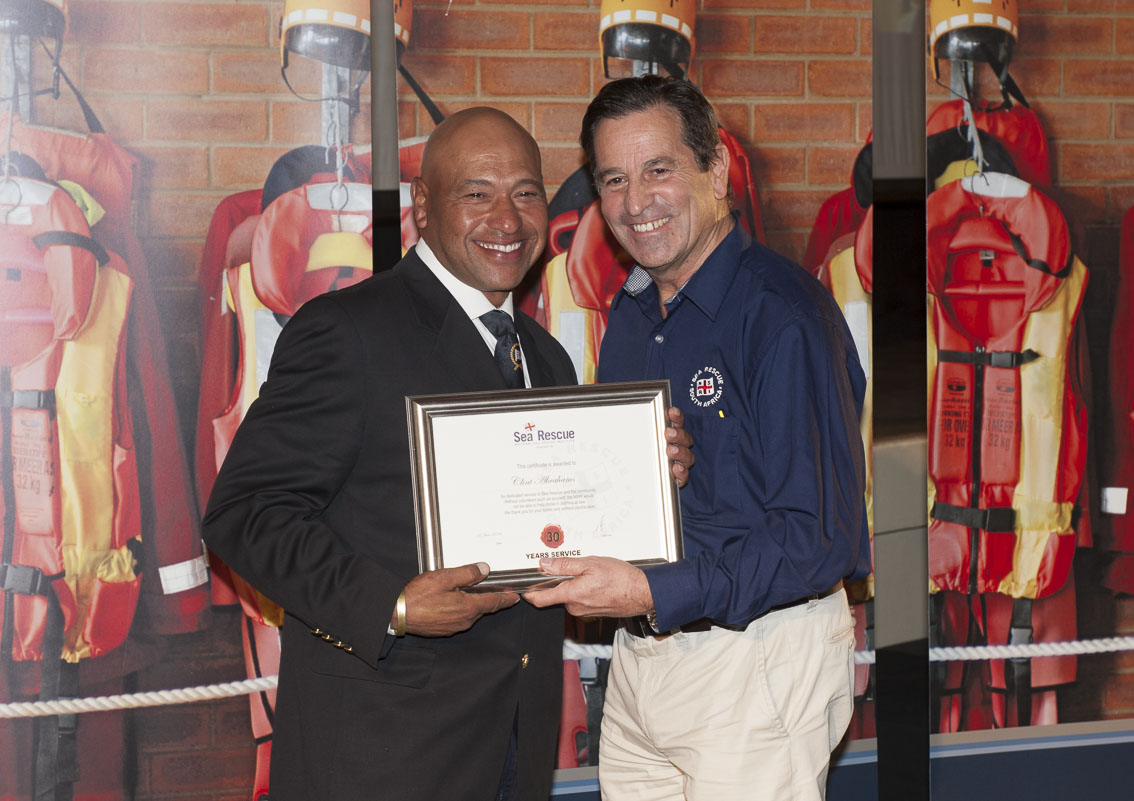 Clint Abrahams receives his 30 years service award from NSRI Chairman Ronnie Stein