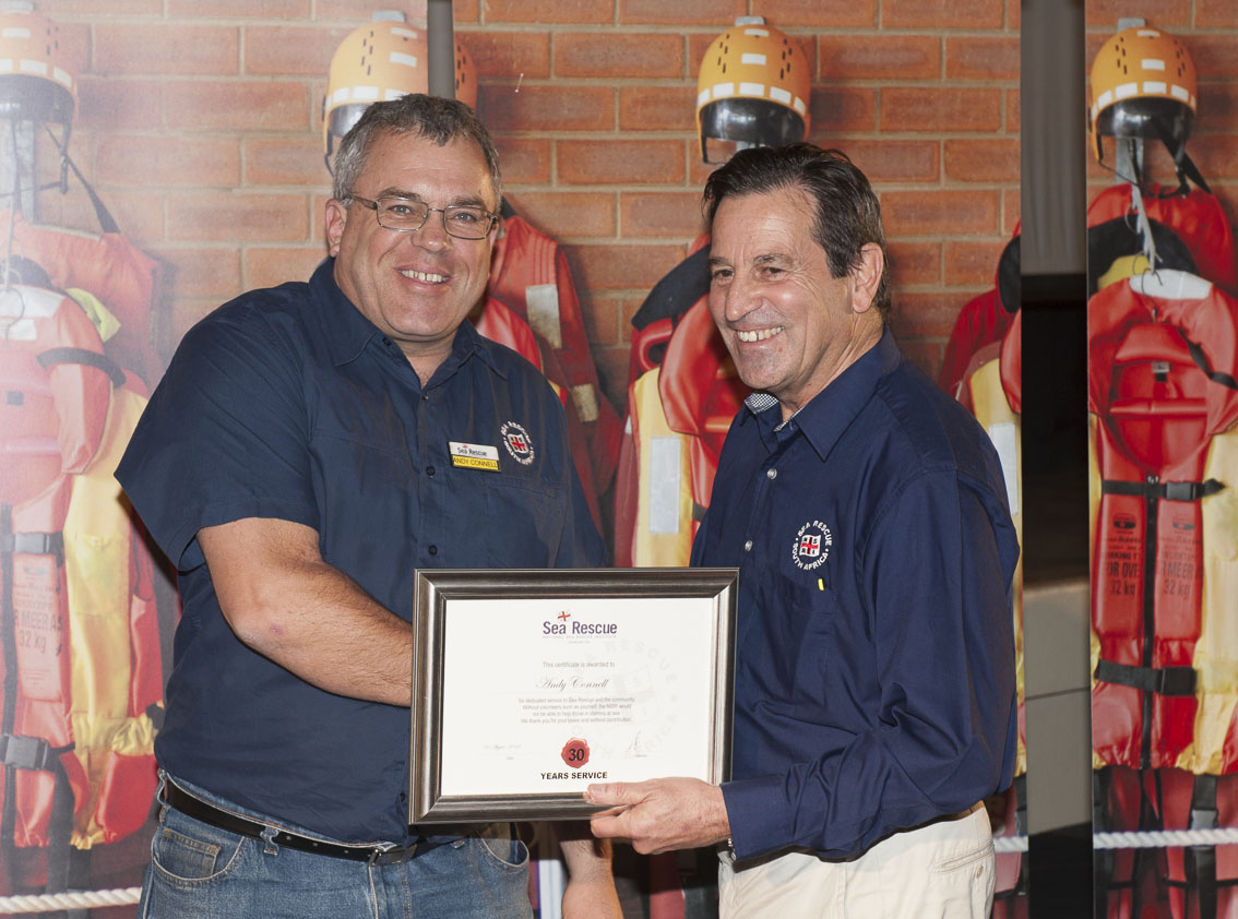 Andy Connell receives his 30 years service award from NSRI Chairman Ronnie Stein