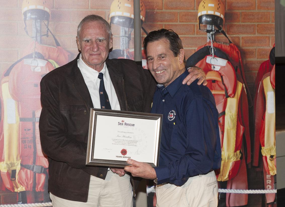 Ian Hamilton receives his 45 years service award from NSRI Chairman Ronnie Stein