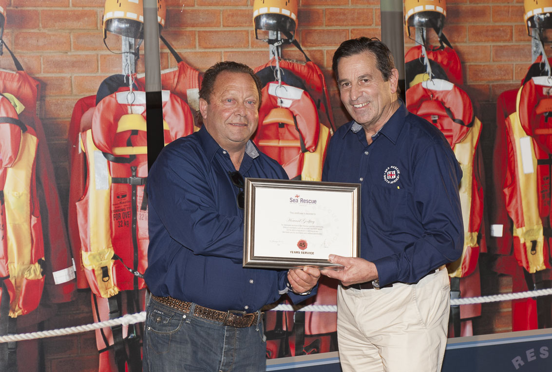 Howard Godfrey receives his 45 years service award from NSRI Chairman Ronnie Stein