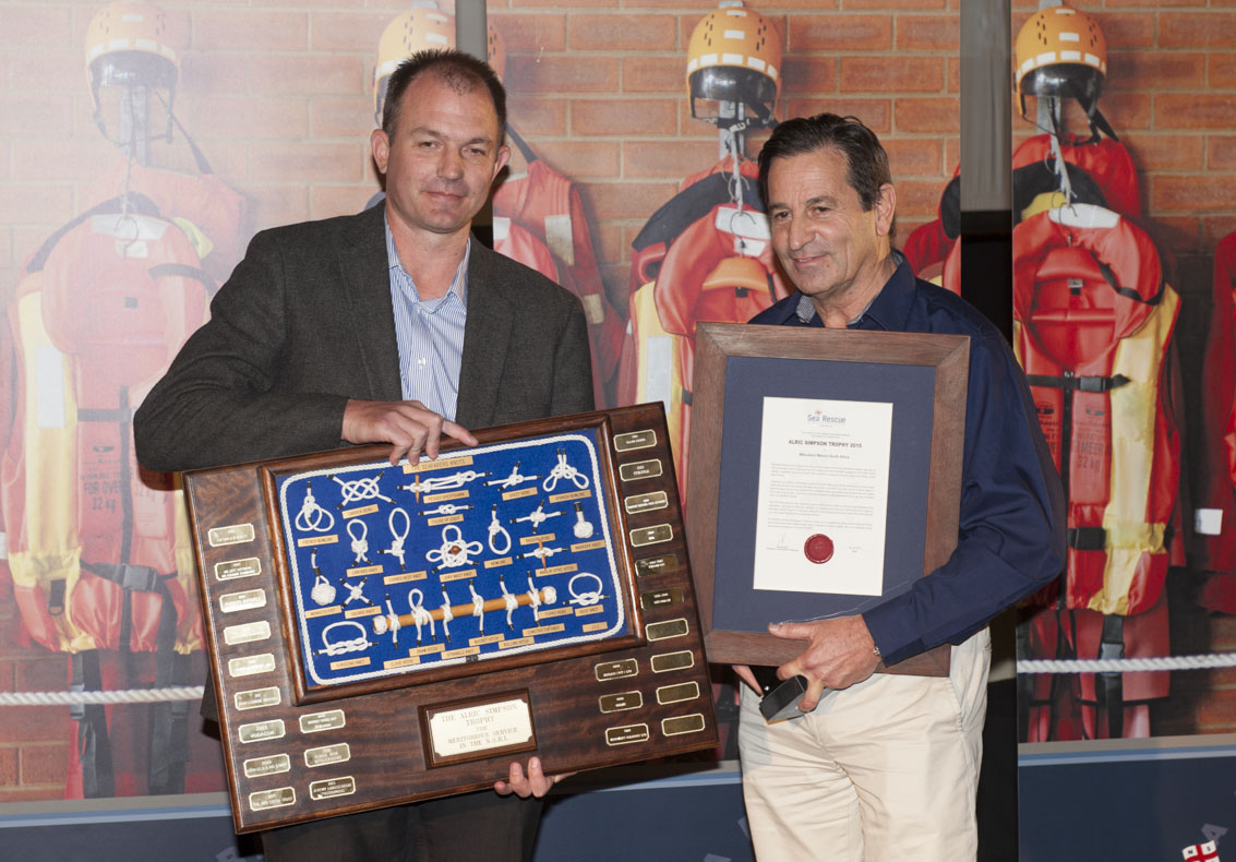 Mitsubishi's COO Wynand Pretorius recieves the ALRIC SIMPSON AWARD from NSRI Chairman Ronnie Stein.